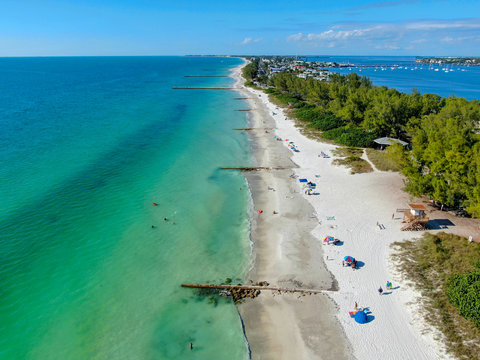 Aerial view of Coquina Beach white sand beach and turquoise water in Bradenton Beach during blue summer day, Anna Maria Island, Florida. USA