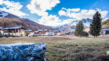 Foto op Aluminium Arctica Livigno village, street view with old wooden houses, Italy, Alps