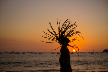 dreadlock young man in sunset