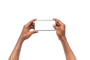 Black male hands taking photo on smartphone with blank screen