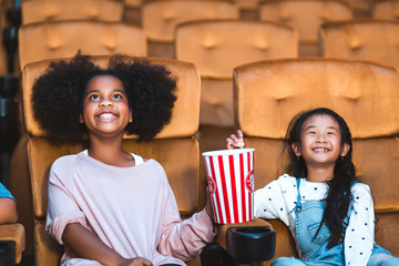 Happy kid watch movie in theater
