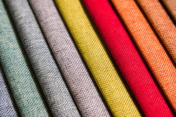 Foto op Canvas Stof Colorful and bright fabric samples of furniture and clothing upholstery. Close-up of a palette of textile abstract diagonal stripes of different colors