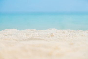 Soft focus white Sand on the beach and blue sea sky.Summer vacation outdoor and travel holiday in...