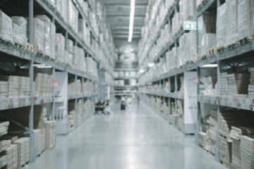 Warehouse industry blur background with logistic wholesale storehouse, Products on shelf.