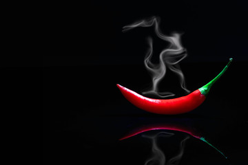 Photo sur cadre textile Hot chili Peppers smoking red hot chili pepper