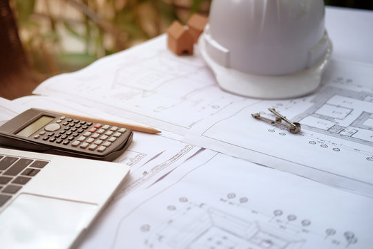 house blueprint of real estate project at architect engineer  workplace. building construction concept