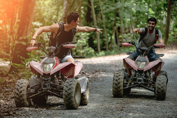 Atv riders speed race to journey through the jungle with Off-road atv car.