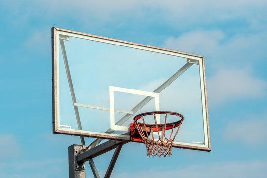 Basketball hoop on a blue sky