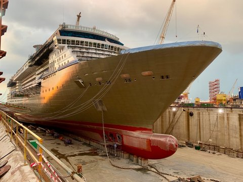 cruise ship in on the dry dock. This is a renovation and referbish of the huge vessel.