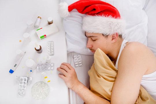 Sick Young Man in Santa Hat