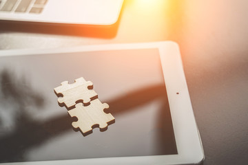 Business solutions, Two piece jigsaw put on tablet. success and strategy and partner concept.