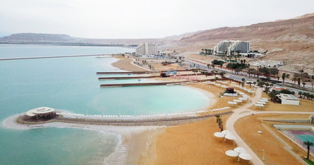Aerial image  of the Dead Sea in israel. POV from the sea to hotels and to the mountains.
