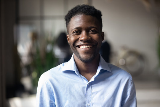 Confident smiling young african businessman looking at camera in office