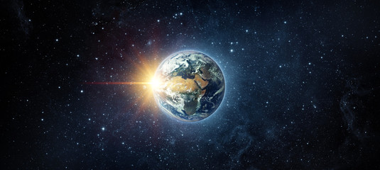 Wall Mural - Panoramic view of the Earth, sun, star and galaxy. Sunrise over planet Earth, view from space. Elements of this image furnished by NASA