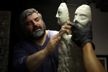 Omar Sartawi, a Jordanian chef recreates an ancient statue found in Jordan using a famous local product - Jameed, at his workshop in Amman