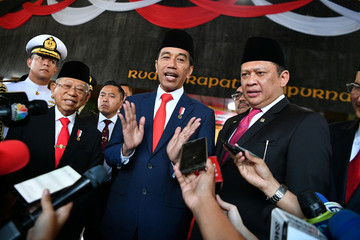 Indonesian President Joko Widodo and his Vice President Ma'ruf Amin talk to journalists after their inauguration and a swearing-in ceremony at the House of Representatives building in Jakarta
