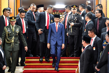 Indonesian President Joko Widodo walks after his inauguration and a swearing-in ceremony at the House of Representatives building in Jakarta
