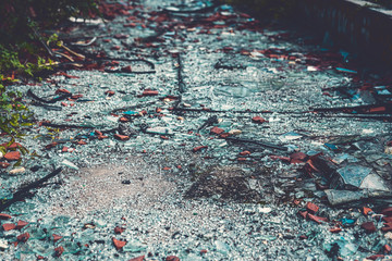 close up of colorful glass shards covering the ground