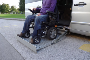 Disabled Men on Wheelchair using Accessible Vehicle with Lift