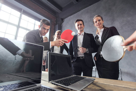 Business people play ping pong