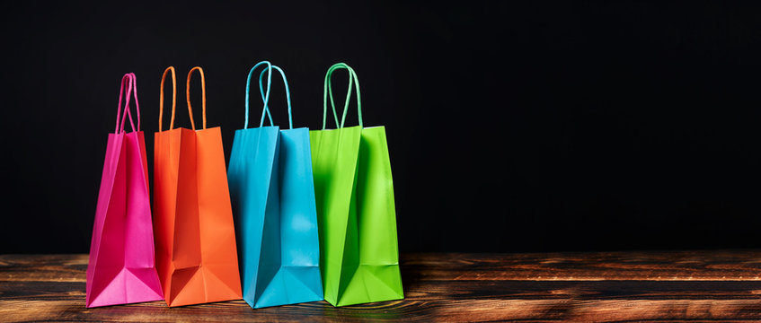 colorful paper bags on black background