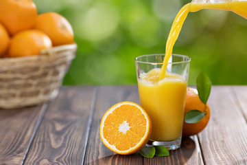 Poster Juice orange juice pouring in glass