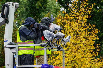 photo and video cameraman working at a event in the rain