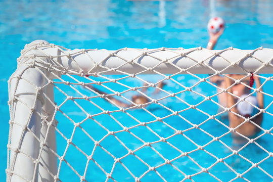Children paly water polo in swimming pool