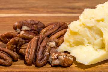 Close shot of pecan nuts and cheddar cheese a classic keto or low carb snack
