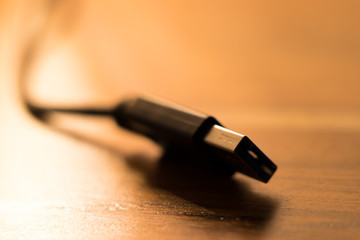 USB cable on wooden desk background
