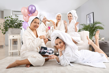Happy young women during hen party at home
