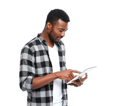 Portrait of handsome African-American man with tablet computer on white background