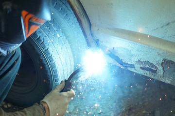 Welding by a semiautomatic device.