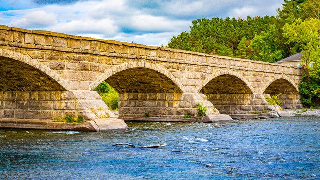 Arched Stone Bridge Over a River