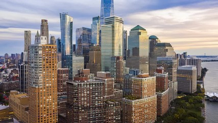 Fototapete - Aerial drone hyperlapse of New York skyline at dusk with camera rotation around Lower Manhattan skyscrapers