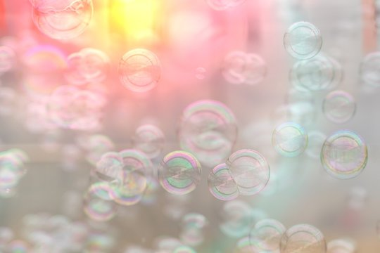 Colorful soap bubbles from the bubble blower