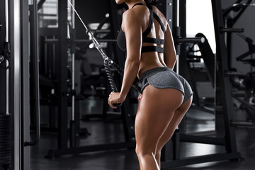 Fitness woman workout in gym. Active girl with shaped glutes. Beautiful buttocks in thong