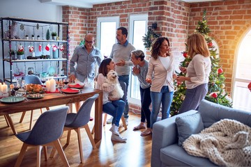 Family and friends dining at home celebrating christmas eve with traditional food and decoration,...