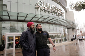 New Democratic Party (NDP) leader Jagmeet Singh poses for a photo with a security guard during an election campaign visit to Guildford Town Centre in Surrey