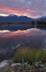 Acrylic Prints Coral Sunrise over a calm pond in Montana.