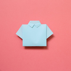 Blue paper shirt origami on pink background