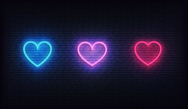Heart neon icons set. Glowing bright red, purple and blue hearts