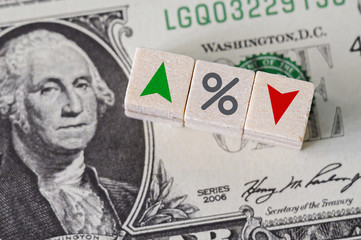 Concept idea of FED, federal reserve system is the central banking system of the united states of america and change interest rates. Percentage icon and arrow symbol on wooden cube