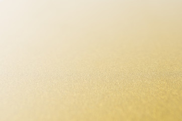 Golden and white glittering glowing bokeh background.