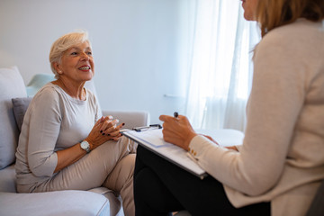 Geriatric psychology, mental therapy and old age concept - Senior woman patient and psychologist at psychotherapy session. Senior woman talking with female psychologist