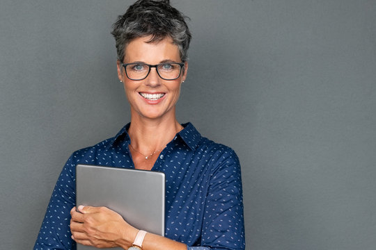 Mature businesswoman holding digital tablet