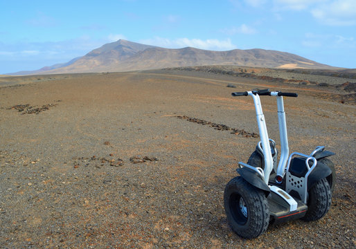 Two Segway machines parked half way through tour through spectacular Lanzarote Landscape,