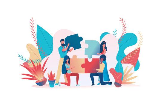 Business team assemble a puzzle. Teamwork metaphor