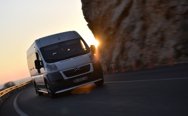 Kas / Turkey - 08.10.18: Drive passenger van of Citroen Relay by mountains road on sunset
