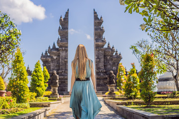 Printed kitchen splashbacks Bali Young woman tourist in budhist temple Brahma Vihara Arama Banjar Bali, Indonesia